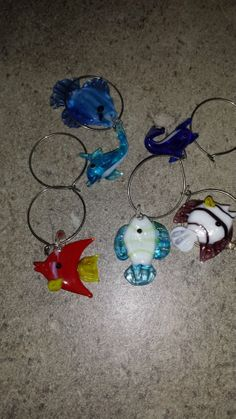 set of 6 blown glass wine glass charms  4 fish, 1 dolphin &1 whale