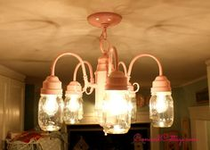 Hi Friends, how are you today? I am great and so excited to finally share my new Mason Jar Chandelier and lighting fixture in my kitchen. Our kitchen is very sh…