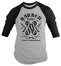 This t-shirt is perfect for any barber. The design crossed barber poles, scissors, a mustache and razor blades for a clean shave. It reads 'Barber Rebel, Fresh Style, Bad*ss Barbershop'. Our cotton t-
