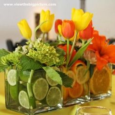 Flower delivery in Buckeye by Buckeye florist - This arrangment is made up of three sqaure vases, one with Limes and Green Hydrangea, one with Lemons and Yellow Tulips and one with Oranges with Orange Lilies. This arrangment can be ordered with just one vase for less or all three. Just call and ask and it can be customized for you. - Citrus Circus