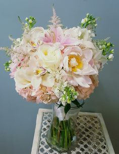 Pink and white Bridal Bouquet: Peonies, Roses,  Cymbidium Orchids,  Stock,  Hydrangea, Astilbi,  Stargazer Lilies. Designed by Scarlett's Flowers