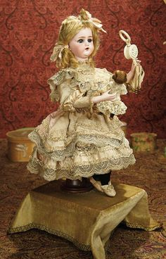 """The Memory of All That - Marquis Antique Doll Auction: 49 All-Original French Automaton """"Little Girl with Doll and Rattle"""" by Leopold Lambert"""
