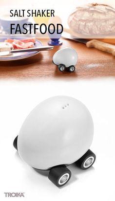 TROIKA FASTFOOD. Egg on wheels, salt shaker, porcelain/plastic, with friction motor *** Ei auf Rädern, Salzstreuer, Porzellan/Kunststoff, mit Rückziehmotor