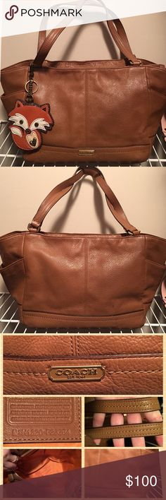 F23284 Coach Brown Leather Carrie Park Tote Purse This is a Carrie Park Tote in Brown.  The Hangtags are included.  They were taken off to put the fox on (not included).  This bag is in good, pre-owned condition.  The bag has a few stray pen marks inside.  The leather is not as stiff at the very top near the zipper as when new.  Smoke and Pet Free.  I have 100+ listings, so please check them out.  Thanks. Coach Bags Totes