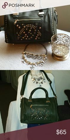 NWT Olive Green Studded Handbag Brand New with Tag Stunning Boutique Handbag perfect as a casual everyday bag. Bag has lots of space for everyday essentials and comes with a shoulder strap for easy carrying.  Dimensions are as listed 13 inches long 10 inches tall 7 inches wide Bags Shoulder Bags