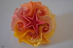 Curly Star Kusudama (Just translate the page into English: the pictures are very self-explanatory.)