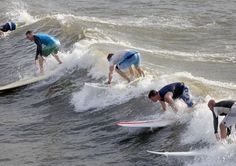 Surfing troops toss hierarchy to waves