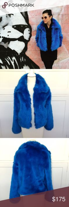 """NWT Amazing Electric Blue Faux Fur Jacket NO TRADES. OFFERS WELCOME. PLEASE USE THE OFFER BUTTON. How amazing is this jacket? It's pretty amazing. New, with tags. Designer donates to animal and children's causes. Fully lined. Hook closure. Length is 21"""". 19"""" across at bustline. 17"""" across at shoulders. Acrylic and polyester. Warm and cozy. More photos on my blog- link in bio. A statement piece!!! 💙💙 n:philanthropy Jackets & Coats"""