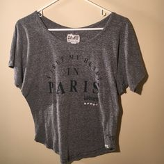"Gray top Gray top with ""I left my heart in Paris... Goodbye"" and 5 hearts printed. Worn but in good condition. Super comfy Forever 21 Tops Tees - Short Sleeve"