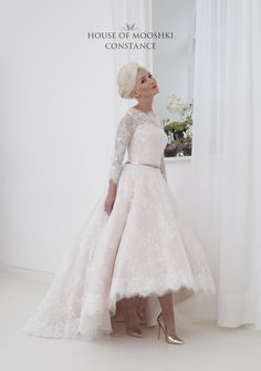 Constance - Amazing couture inspired blush and ivory high/low wedding dress. Shown in blush with ivory lace overlay, this dress is perfect for any bride. The bodice features a soft dip neckline that is framed by the illusion lace neckline. 3/4 sleeves and a daring low back finish off the look perfectly. Calf length at the front and with a sumptuous full length train to the back, Constance is so elegant and glamorous - just perfect.