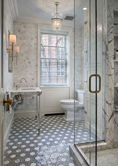 Hexagon marble walls, frameless glass, and vintage style sink | via Brownstoner.com: fittings from Waterworks and tiles from Urban Archaeology.