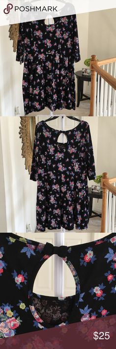 """LC Lauren Conrad Floral Dress From LC Lauren Conrad! The dress is cotton and has some stretch. It's fitted throughout the waist and the skirt flares out. The sleeves are 3/4 length and features a cute key hole with a bow on the back. The length on me (I'm 5""""1) comes right at my knees. I'm 44 inches in the bust and 40 in the waist and I can still wear it. The fabric and the colors are rich and bold! Great condition! Size XL  So darling you'll add to the cart! LC Lauren Conrad Dresses"""
