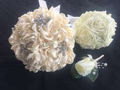 satin roses with pearls and starfish brooches
