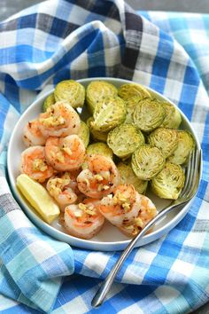 Healthy One Pan Lemon Garlic Shrimp & Brussels Sprouts! An amazing flavor combination of tender, garlicky shrimp that comes together in 20 minutes! Gluten Free + Low Calorie + Paleo For the recipe, click here.