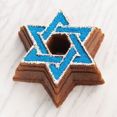 The Nordic Ware Star of David Bundt Pan makes a stunning cake in the shape of the Star of David. Perfect for Jewish holidays and Bar and Bat Mitzvahs. Happy Hanukkah, Hannukah, Macaroon Cake, Light Cakes, Star Cakes, White Cake Mixes, Nordic Ware, Festival Lights, Star Of David