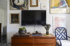 Dan has great taste and with a few choice pieces already in his apartment, he was more interested in rounding out the softer elements in his SoHo apartment. Tour the slideshow to see the space and his designer Logan's tips for accessorizing.