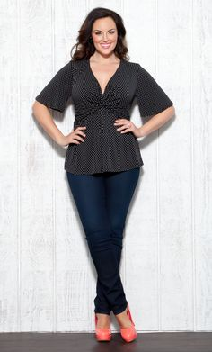 We're dotty for the Plus Size Abby Twist Top by Kiyonna! This playful polka dot top is super cute when paired with skinnies or white denim. #plussize #kiyonna