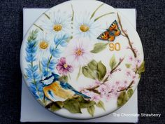 I was asked to create a cake for a lady celebrating her 90th birthday. She loves watching the birds in her garden.
