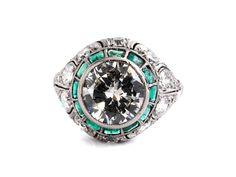Ringweite: 53/ 54. Gewicht: ca. 5,6 g. Platin. Um 1910. Antiker, schön gearbeiteter Ring mit zentralem Altschliffdiamant, 2,48 ct K/L VS/SI, einer Entourage...