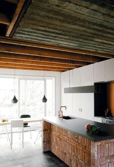 """Brick kitchen island from the book """"Dutch Architects and Their Homes"""". Regal Industrial, Industrial Interiors, Industrial Closet, Industrial Shop, Industrial Windows, Industrial Restaurant, Kitchen Industrial, Industrial Apartment, Industrial Office"""