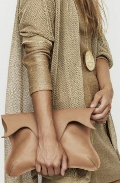 All neutral gold with an oversized clutch