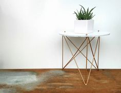 Sweet little plant stand.  Wire Hairpin legs and a fiberboard top. Little gold ball screw heads for accent.  Recently spray painted to give