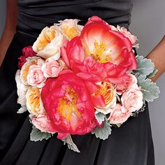 Coral charm peonies / peach Juliet garden roses / Dusty Miller. These would pop great off of peacock blue dresses!