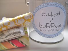 great idea to package homemade burp cloths in a bucket...I have seen them at Michael'.  An she even has a free printable label!