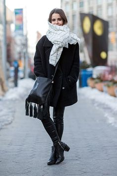 How To Wear A Blanket Scarf Without Looking Like You're Napping #refinery29  http://www.refinery29.com/blanket-scarf-outfits#slide-4  A large, square piece of fabric can easily turn into a blanket scarf. Fluff it up and then make one or two loose knots off to the side....