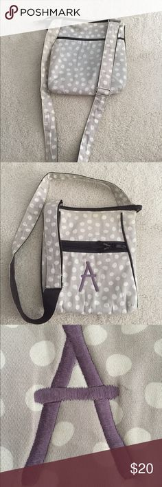 Thirty One Crossbody with A monogram This crossbody is slightly worn with a little discoloration and some loose threads. It has 2 outer pockets and 3 inner pockets also with an adjustable strap. thirty one Bags Crossbody Bags