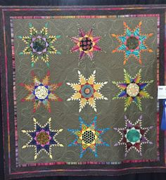Sew Fun 2 Quilt: HMQS SLC. Feathered Star by Lisa Curnutt won First Place in Novelty Custom. Notice how the pink star looks like it is trimmed with lace.