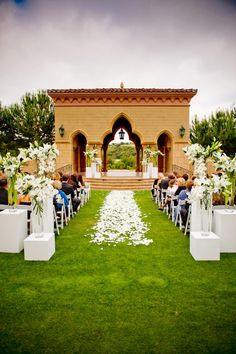 Steve Finley and Meaghan Hunt were married in an outdoor ceremony staged amid The Grand Del Mar's Moroccan-style pavilion. The grassy aisle was covered in white petals and flanked by pedestals topped with tall floral arrangements. #weddingceremony #decor Photography: True Photography Weddings. Read More: http://www.insideweddings.com/weddings/meaghan-hunt-and-steve-finley/434/