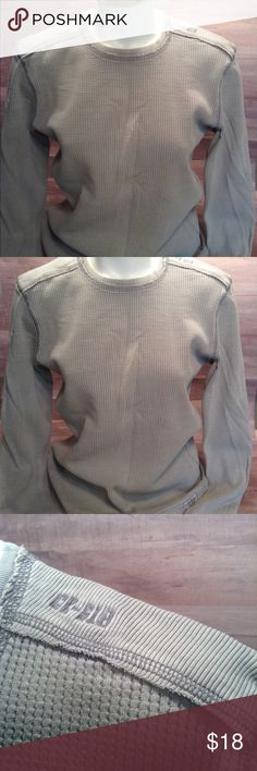 """Men's Calvin Klein Thermal Shirt Pale gray thermal with great detail stitching as showed in pictures. Really nice condition with the exception of 3 tiny marks on one wrist cuff. This is not really noticed when wearing. Measures 19"""" at chest and 24.5"""" long. Calvin Klein Shirts Tees - Long Sleeve"""