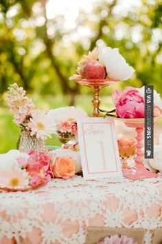 So awesome - Lace tablecloth over peach fabric | CHECK OUT MORE GREAT PINK WEDDING IDEAS AT WEDDINGPINS.NET | #weddings #wedding #pink #pinkwedding #thecolorpink #events #forweddings #ilovepink #purple #fire #bright #hot #love #romance #valentines #pinky