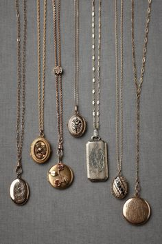 Collector's Lockets from BHDLN: Each locket is handpicked based on exquisite details such as unique clasps, silhouettes and metal work, as well as original engravings and photographs which have remained intact. Each is estimated to date anywhere from the early 1900s to 1940s.