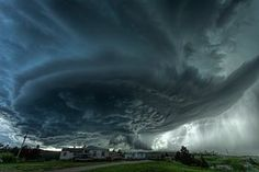A supercell thunderstorm rises over the town of Blackhawk, South Dakota.