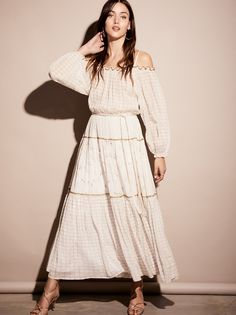 Esmerelda Maxi Dress | Femme, flowy maxi dress featuring a soft mixed print with gold embroidered accents and a pretty cold shoulder neckline.    * Elastic at the neckline, waist and sleeve cuffs   * Rope belt at the waist   * Lined