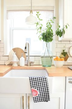 Summer Home Tour Kitchen Updates. Farm Sink, fresh clippings and summer dish towel...easy updates!