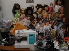 This is my work area a bit organized but this is about only about half of my dolls.