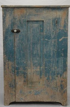 Primitive Hudson Valley 19th. Century Raised Panel Cupboard...scraped down to the original Robins Egg Blue.