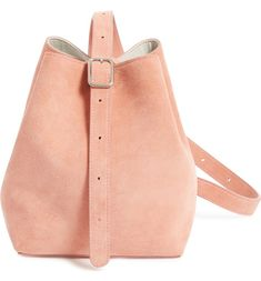 Soft, pink suede refines this spacious shoulder bag crafted with a tethered, detachable wallet.