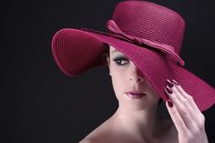https://flic.kr/p/ooqFYc   Classic   Softbox above and to the right coming down onto the hat. Another softbox left and low facing up to model.