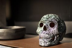 Decorative black clay skull by Espacio Sami Hayek at the 2011 International Contemporary Furniture Fair