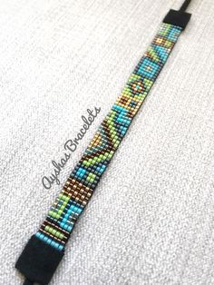 NEW!!! Green Blue Gold Bronze Miyuki Bracelet with black suede ending / Beaded Bracelet / Boho Style / Miyuki Bead Bracelet / Miyuki Delica by AyshasBracelets on Etsy https://www.etsy.com/uk/listing/593613271/green-blue-gold-bronze-miyuki-bracelet