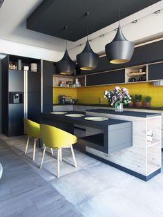 îlot central design avec éclairage style industriel cuisine moderne noire touches jaunes