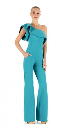 Stretch jersey Jumpsuit. Plain, ruffled one-shoulder neckline, diagonal pockets, flared leg. Raw edge hem for ease of tailoring, will not fray if cut.