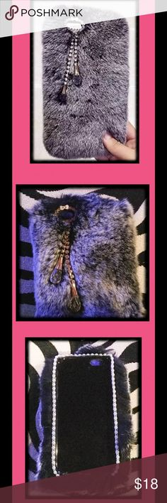 💕Fur iPhone 6 case NWOT! 💕 BRAND NEW! 1st pic is stock photo This was a Christmas gift, and doesn't fit my new phone. The description from the original seller, read rabbit fur, but there was no paperwork with it to provide proof. It is SO soft, and adorable! Has beautiful faux stones around the camera hole, and tassels of stones too! The inside is trimmed in a cute & classy pearl ribbon. I loved it so much, that I bought another to fit my phone!! This one is for an iPhone 6. It comes in a…