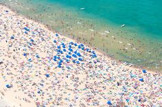 """Signed by Gray Malin, this aerial image of Chicago's Oak Street Beach comes from his """"À la Plage"""" series. Shot from doorless helicopters, this series takes an overhead look at beach and pool scenes..."""