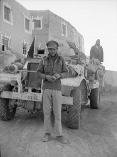 Captain David Lloyd Owen with Private 'Tich' Cave on the back of the 30 cwt truck behind, outside the Farouk Hotel in Siwa. Lloyd Owen joined the Yeomanry ('Y') Patrol of the Long Range Desert Group.