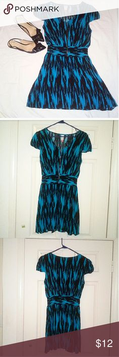 Stylish blue and black casual dress This dress with its striking blue color and black abstract stroke pattern is a must have to add a touch of spunk and edge to your office ensemble.   This dress boasts capped sleeves, a v-neckline, zippered front, stretch bodice, and a flowy skirt. Pair with a statement necklace and funky pointed heels for that edgy vibe!  Size L. Stretchy material. It can fit a M but top portion may be slightly loose. In excellent condition. No Boundaries Dresses Midi